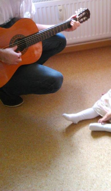 Playing guitar for one of the family kids