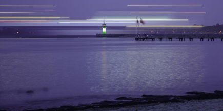 Long exposure of a ship in Travemünde pink photo