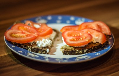 Granary bread with fresh cheese and tomatoes