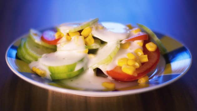 Fresh salad with cucumber, tomato, maize and garlic sauce