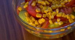 Fresh salad with cucumber, tomato, maize and garlic sauce