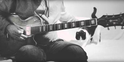 Guitar player and his cat