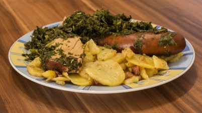 Kale with fried potatoes, smoked pork chop and smoked sausage