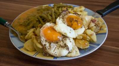 fried potatoes with green beans cream sauce and fried eggs