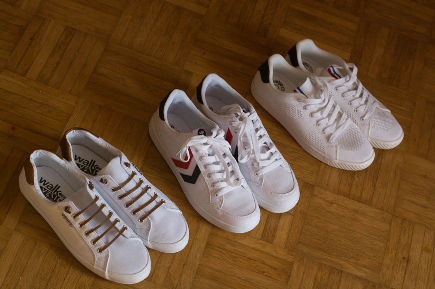 three pairs of white sneakers
