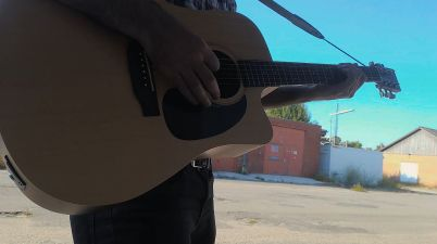 playing acoustic guitar outside
